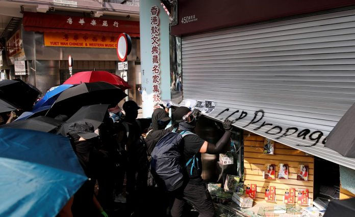 Anti-government demonstrators vandalize a shop during a protest in Hong Kong, China, October 20, 2019. REUTERS