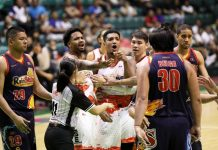 Phoenix Pulse Fuel Masters' Jason Perkins is restrained by teammates from confronting Rain or Shine Elasto Painters' Beau Belga during their 2019 PBA Governors' Cup game last night. PBA PHOTO