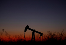 An oil pump is seen just after sunset outside Saint-Fiacre, near Paris, France Sept. 17. CHRISTIAN HARTMANN/REUTERS