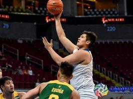 Ateneo de Manila University Blue Eagles' Pat Maagdenberg scores a hook shot after losing his defender Barkley Ebona of Far Eastern University Tamaraws. UAAP PHOTO
