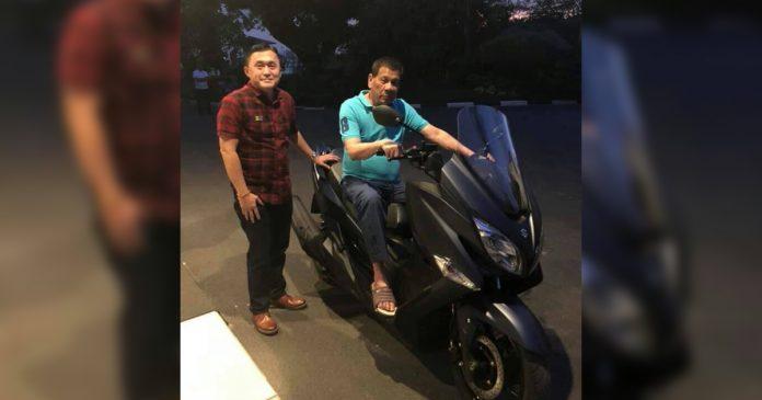 President Rodrigo Duterte is seen riding a scooter of Sen. Bong Go Thursday night at Bahay Pagbabago. SEN. BONG GO