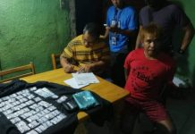 Drug suspect Rene Tobongbanua (seated on the right) was arrested in an entrapment operation in Barangay Mansilingan, Bacolod City on Oct. 16. BACOLOD CITY POLICE OFFICE STATION