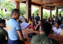 "Sagay City police station chief Major Antonio Benitez Jr. (standing) with officers of the Philippine Army's 79th Infantry Battalion meets with the families of the ""Sagay 9"" victims on Oct. 20. 79IB/Philippine Army"