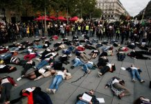 "People stage a ""die-in"" at Place de la Republique during a demonstration against domestic violence in Paris, France on Oct. 19. REUTERS/BENOIT TESSIER"