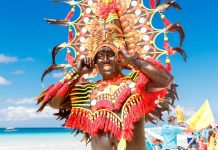Man in a colorful headdress during the Ati-Atihan celebration in Boracay Island, Malay, Aklan. The Kalibo Santo Niño Ati-Atihan Management Council Incorporated is eyeing to revive the classic 1980s favorite – the snake dancing tradition in the capital town. FROLOVA_ELENA/ SHUTTERSTOCK