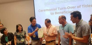 "TURNOVER. Cabinet Secretary Karlo Nograles (3rd from left) formally turn overs super typhoon ""Yolanda"" housing units to beneficiaries on Nov. 19, 2019 in Iloilo City. In photos are (from left) National Housing Authority NHA) Region 6 manager Engineer Grace Guevarra, NHA Iloilo/Guimaras district manager Ma. Luz Ysatam, Nograles, Mayor Seigfredo Betita of Carles, Iloilo and Cong. Raul Tupas of Iloilo's 5th District. All housing projects in areas hit by 2013's super typhoon ""Yolanda"" would be fully completed by 2020, according to Nograles who also chairs the Inter-agency Task Force Yolanda. GLENDA SOLOGASTOA/PN"