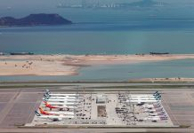 Cathay Pacific Airways planes are parked at Hong Kong International Airport, China. Several Asian airlines have cut flights to Hong Kong over the coming weeks as anti-government protests in the city grow increasingly violent and disrupt daily life. AMR ABDALLAH DALSH/REUTERS