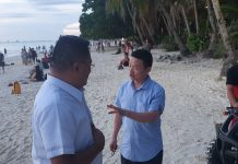 Chinese Embassy Consul General Lou Gang gives instructions to Chinese liaison officer Peter Tay during their visit in Boracay Island, Malay, Aklan. JUN AGUIRRE/PN