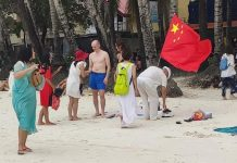 There photos that went viral on social media over the week show an unidentified tourist planting a Chinese flag in the sands of world-famous Boracay Island in Malay, Aklan. The island's inter agency task force says it will launch a probe into the motive of the tourist. CONTRIBUTED PHOTO