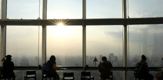 People are seen drinking coffee at the top of the Mori Tower in Roppongi, Tokyo, Japan. Despite a steady increase in coffee consumption around the world, trade prices have fallen dramatically in the past three years, hitting producers. MATTHEW CHILDS, REUTERS