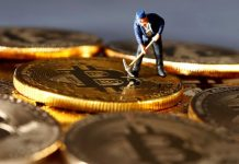 A small toy figure is seen on representations of the Bitcoin virtual currency in this illustration picture, Dec. 26, 2017. DADO RUVIC/REUTERS