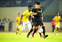 Ceres-Negros FC's Dennis Villanueva controls the ball as a Kaya Futbol Club-Iloilo defender chases. KAYA-ILOILO PHOTO