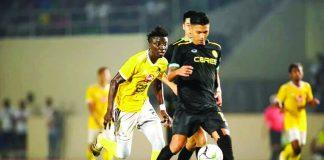 Ceres-Negros FC's Dennis Villanueva controls the ball as a Kaya Futbol Club-Iloilo defender chases. KAYA-ILOILO PHOTO