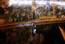 Anti-government protesters trapped inside Hong Kong Polytechnic University abseil onto a highway and escape before being forced to surrender during a police besiege of the campus in Hong Kong, China on Nov. 18. HK01/HANDOUT VIA REUTERS