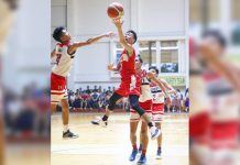 Hua Siong College of Iloilo Red Phoenix's Julian Maverick Puerto stretches for a layup. PHOTO COURTESY OF WINMEL LEE