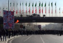 Smoke rises during a protest in the central city of Isfahan, Iran, Saturday. Demonstrators angered by a 50-percent increase in government-set gasoline prices blocked traffic in major cities and occasionally clashed with police after a night of demonstrations punctuated by gunfire. AP