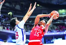 San Beda University Red Lions' James Canlas goes for a tough inside hit. TIEBREAKER TIMES PHOTO