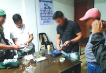 Antidrug operatives inspect the seized sachets of suspect shabu from Mark Andrew Panganiban (2nd from the left). PDEA REGION 6