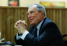 Michael Bloomberg, the billionaire media mogul and former New York City mayor, eats lunch with Little Rock mayor Frank Scott, Jr. after adding his name to the Democratic primary ballot in Little Rock, Arkansas, United States, Nov. 12.