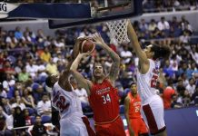 NorthPort Batang Pier's Christian Standhardinger is foiled by Barangay Ginebra San Miguel Kings' Justin Brownlee. PBA PHOTO