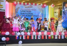 "The students of Paul Learning Center in their national costumes singing ""It's A Small World After All."""