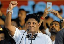 Sajith Premadasa, Housing Minister and the presidential candidate of the United National Party, gestures at his supporters during his first election campaign rally in Colombo, Sri Lanka on Oct. 10. REUTERS/DINUKA LIYANAWATTE