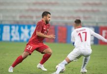A Syrian player tries to dribble the ball past Stephen Schrock of the Philippine Azkals in their second round matc up in the joint 2022 FIFA World Cup and 2023 Asian Cup Qualifiers held in Dubai on Tuesday. AFC
