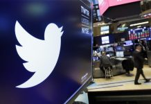 The logo for Twitter is displayed above a trading post on the floor of the New York Stock Exchange. In a policy published Friday, Twitter said it is banning ads that contain references to political content, including appeals for votes, solicitations of financial support and advocacy for or against political content. The ban also includes any ads by candidates, political parties, elected or appointed government officials. RICHARD DREW/AP
