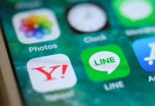 The icons for the Yahoo Japan and Line applications are displayed on a smartphone. GETTY IMAGES