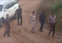 Still frame taken from Dec. 6 video shows Cyberabad Police Commissioner V.C. Sajjanar and other police officers arriving at a spot where police shot dead four men suspected of raping a veterinary doctor, in Hyderabad, Telangana, India. ANI/VIA REUTERS TV
