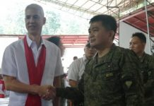 Army Colonel Inocencio Pasaporte (right), who assumed as commander of the 303rd Infantry Brigade based in Murcia, Negros Occidental on Dec. 12, meets Gov. Eugenio Jose Lacson after the change of command held at the brigade headquarters. PNA/NANETTE L. GUADALQUIVER
