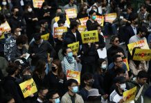 Anti-government demonstrators gather for a lunchtime protest at Chater Garden in Hong Kong, China on Dec. 2. REUTERS/LEAH MILLIS