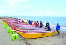 Beneficiaries of the Peter Project with their motorized fishing boats