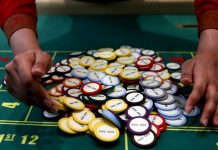 A casino dealer collects chips at a roulette table in Pasay City, Metro Manila, Philippines. Demand for office spaces in the Philippines posted a record-high of 1.7 million square meters this year, driven mainly by higher demand from the gambling industry. REUTERS/ERIK DE CASTRO