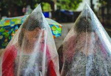 Residents use plastic bags to cover themselves from ash spewed from Taal Volcano's unrest. Mariton Bornas, personnel of the Philippine Institute of Volcanology and Seismology, said a prolonged eruption could pose a serious challenge for the locals. EZRA ACAYAN/GETTY IMAGES/CNN.COM