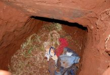 Clothes remain in a tunnel entrance where at least 75 inmates escaped on Sunday at Pedro Juan Caballero city jail in Paraguay. AP/MARCIANO CANDIA
