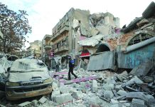 Syrian walks on the rubble of a building following an airstrike in Idlib on Jan. 15,2020. AFP