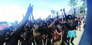 Revelers paint themselves black with soot to imitate the native Atis tribesmen to celebrate the Ati-Atihan Festival in Kalibo, Aklan on Jan. 12. JUN AGUIRRE/PN