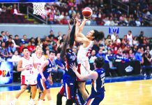 Barangay Ginebra San Miguel Kings' Japeth Aguilar attacks the defense of Meralco Bolts' Allen Durham for an inside hit. PBA PHOTO