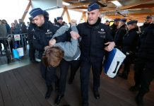 A demonstrator is carried away by police officers during a protest of the climate action group Extinction Rebellion at a motor show in Brussels, Belgium on Jan. 18. REUTERS/YVES HERMAN