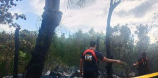 Officers of the Bureau of Fire Protection check the remains of houses destroyed after fire hit Barangay Cagbang, Oton, Iloilo on Jan. 3. IAN PAUL CORDERO/PN