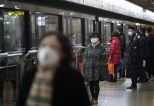 People wearing protective masks are seen at a subway station in Shanghai, China on Jan. 23. REUTERS/ALY SONG