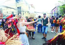 "Foreign visitors join the merry-making with the energized warriors of various ati-ati tribes during the first-ever ""Dagyang sa Calle Real"" on the stretch of Iloilo City's Calle Real (JM Basa Street) on Saturday. IAN PAUL CORDERO/PN"