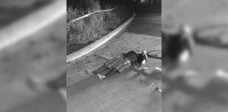 Drugs suspect Richard Tutop, 32, lies dead on the road in Barangay Mansilingan, Bacolod City on Thursday. Earlier, Tutop was reportedly abducted by unidentified men. POLICE STATION 7/ BCPO