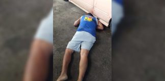 Onel Arandez, councilman of Barangay Punta Tabuc, lies lifeless on the ground after three unidentified suspects peppered him with bullets at a repair shop in Barangay Cagay, Roxas City, Capiz on Jan. 7. GLENN BEUP/PN