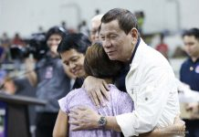 President Rodirgo Duterte leads the distribution of family food packs to the victims affected by the Taal Volcano eruption during his visit at the Batangas City Sports Coliseum on Tuesday. Duterte warned residents not to go back to their homes as Alert Level 4 remains in the 14-km danger zone. PCOO