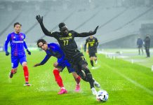 Ceres-Negros FC's Robert Lopez Mendy shields the ball against a Japanese defender. CERES NEGROS F.C.PHOTO
