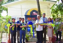 National Water Resources Board executive director Sevillo David Jr. and Science and Technology secretary Fortunato de la Peña (3rd and 4th from left) cut the ribbon during the installation of telemetry sensors for water quality monitoring at Pavia National High School in Iloilo's Pavia town. JULIUS GABIOTA