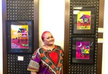 The artist at a previous exhibition with her watercolor paintings.