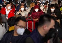CHINA. Travelers wear face masks as they sit in a waiting room at the Beijing West Railway Station in Beijing, Tuesday, January 21, 2020. A fourth person has died in an outbreak of a new coronavirus in China, authorities said Tuesday, as more places stepped up medical screening of travelers from the country as it enters its busiest travel period. AP